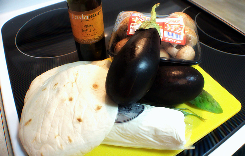 Eggplant tacos are ridiculously simple. You don't have to use truffle oil; regular olive oil will suffice, but if you have some, it will definitely add to the flavor palette.