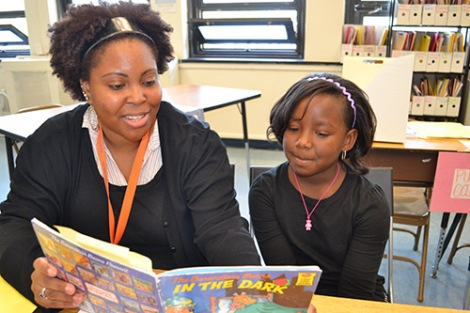 Site Coordinator, Sharae Felder and a student at Friendship Acad- emy at Cherry Hill. Photo courtesy of Reading Partners