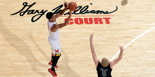 Freshman guard Melo Trimble shooting a three-pointer over Ty Greene of USC-Upstate. Trimble recorded his first career double-double in the game with 14 points and 12 rebounds. Maryland Terps Vs. USC-Upstate on Dec. 13.  Photo Credit: Zack Bolno