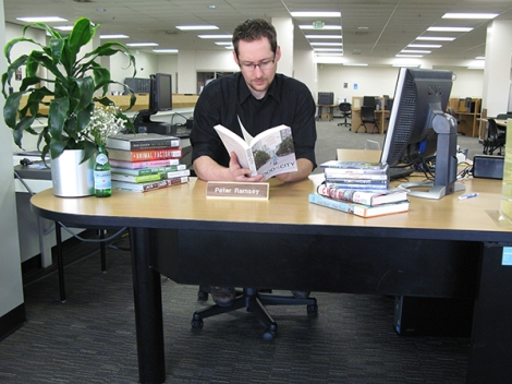 Reference and instruction Librarian Peter Ramsey checks out books on food.