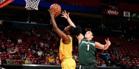 Maryland's Laurin Mincy goes up against a Michigan State defender for a layup during their game Jan. 22 at Xfinity Center in College Park, Md.  Photo Credit: Maryland Athletics.