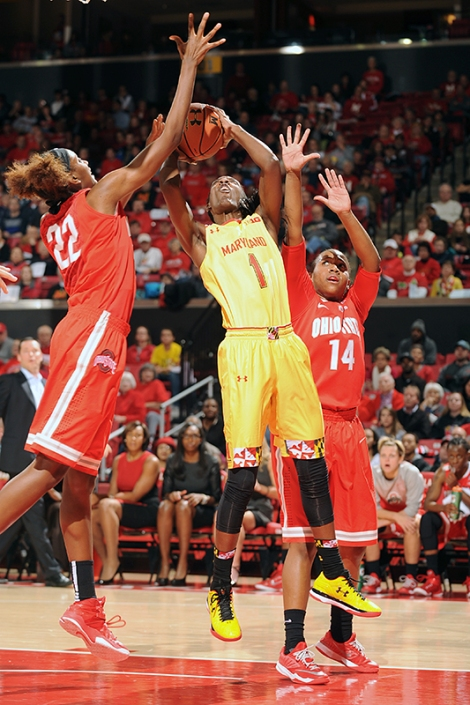 Senior Guard Laurin Mincy goes up for a layup attempt between two defenders during Maryland's Big Ten opener against Ohio State.  Photo Credit: Maryland Athletics Department.