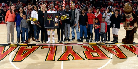 Maryland redshirt senior Laurin Mincy (seventh from left, holding picture frame) is joined by her family and head coach Brenda Frese during an on-court ceremony prior to Maryland's final home game of the season against Indiana. Photo courtesy Maryland Athletics.