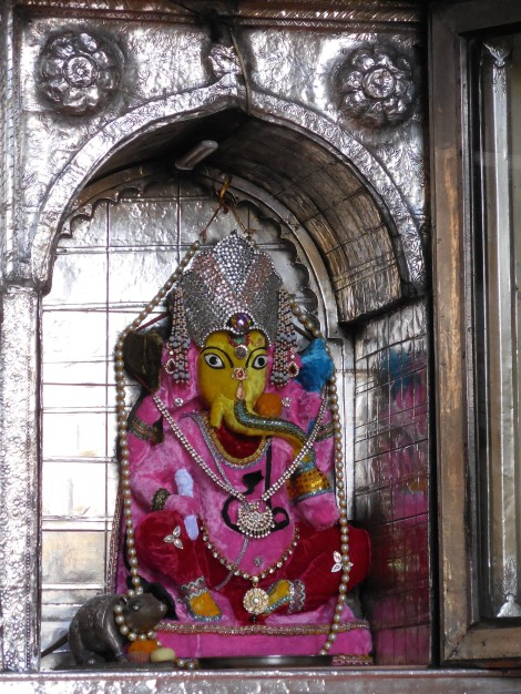 Small shrines, sometimes built into walls in public places, are common throughout India. Ganesh, one of the most widely worshiped of the millions of Hindu gods, is also commonly found in household shrines. This elephant-headed god is said to bring good luck to his devotees.
