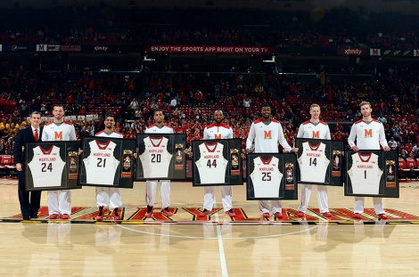 Maryland head coach Mark Turgeon (far left) stands with Maryland seniors (from left to right) Jacob Susskind, Varun Ram, Richaud Pack, Dez Wells, Jon Graham, Spencer Barks and Evan Smotrycz during Senior Day ceremonies. Photo courtesy Maryland Athletics