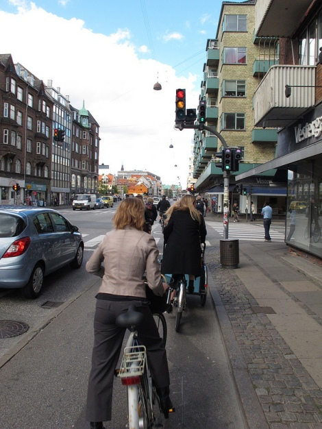 In Copenhagen, sidewalks, streets and bike lanes are built at different levels, enhancing safety for all users. Bike lanes even have their own traffic lights. Photo by Eric Gilliland Flickr Creative Commons