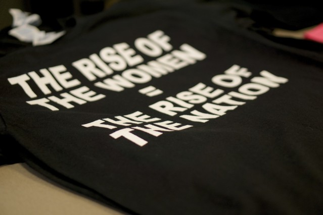 The Women of Color Student association black and white t-shirts shown here are sold in various sizes for $10 each.