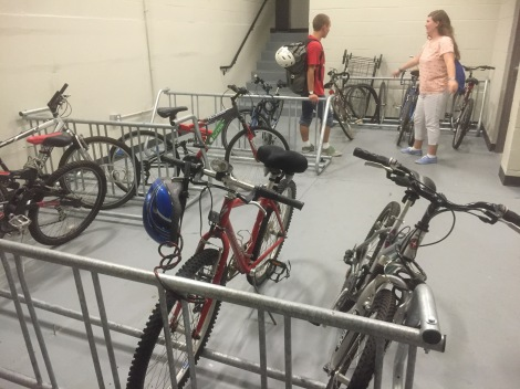 UB students Scott Thomsen and Christine Wertz check out the bike room that provides longterm and overnight bicycle storage for residents of the Varsity, near campus. How many students living in midtown don't have access to a bike room? Photo Credit: Laura Melamed